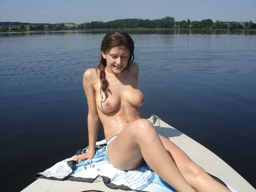 Out In The Open Water On A Boat Is College Girl Who Naked And